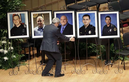 "<div class=""meta image-caption""><div class=""origin-logo origin-image ap""><span>AP</span></div><span class=""caption-text"">Portraits of five fallen officers are arranged prior to a memorial service at the Morton H. Meyerson Symphony Center (AP Photo/Eric Gay)</span></div>"