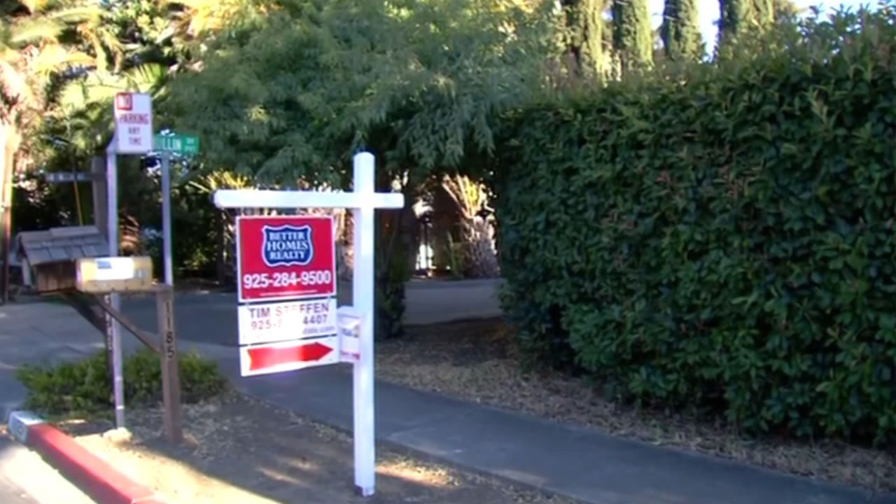 "A ""for sale"" sign hangs in front of a home in Concord, Calif. on Tuesday, July 12, 2016."