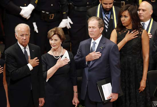 <div class='meta'><div class='origin-logo' data-origin='AP'></div><span class='caption-text' data-credit='AP Photo/Eric Gay'>From left, Vice President Joe Biden, Laura Bush, former President George W. Bush, and first lady Michelle Obama</span></div>