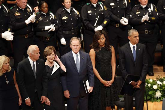 <div class='meta'><div class='origin-logo' data-origin='AP'></div><span class='caption-text' data-credit='AP Photo/Eric Gay'>President Barack Obama stands with, from left, Jill Biden, Vice President Joe Biden, Laura Bush, former president George W. Bush and first lady Michelle Obama</span></div>
