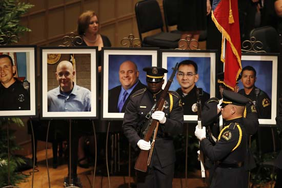 "<div class=""meta image-caption""><div class=""origin-logo origin-image ap""><span>AP</span></div><span class=""caption-text"">Portraits of the five fallen police officers are seen at rear as a memorial gets underway (AP Photo/Eric Gay)</span></div>"