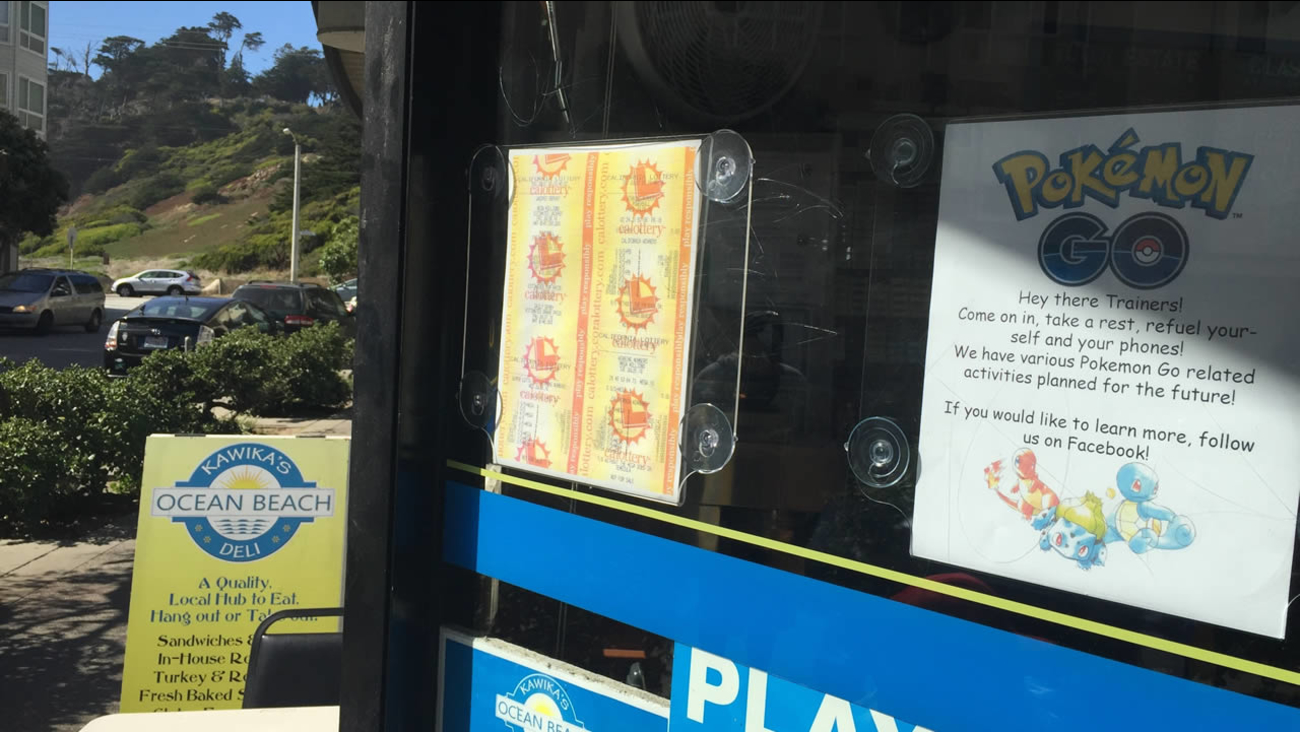 A sign outside of Kawika's Ocean Beach Deli advertises Pokemon Go related activities to passersby in San Francisco, on Monday, July 11, 2016.