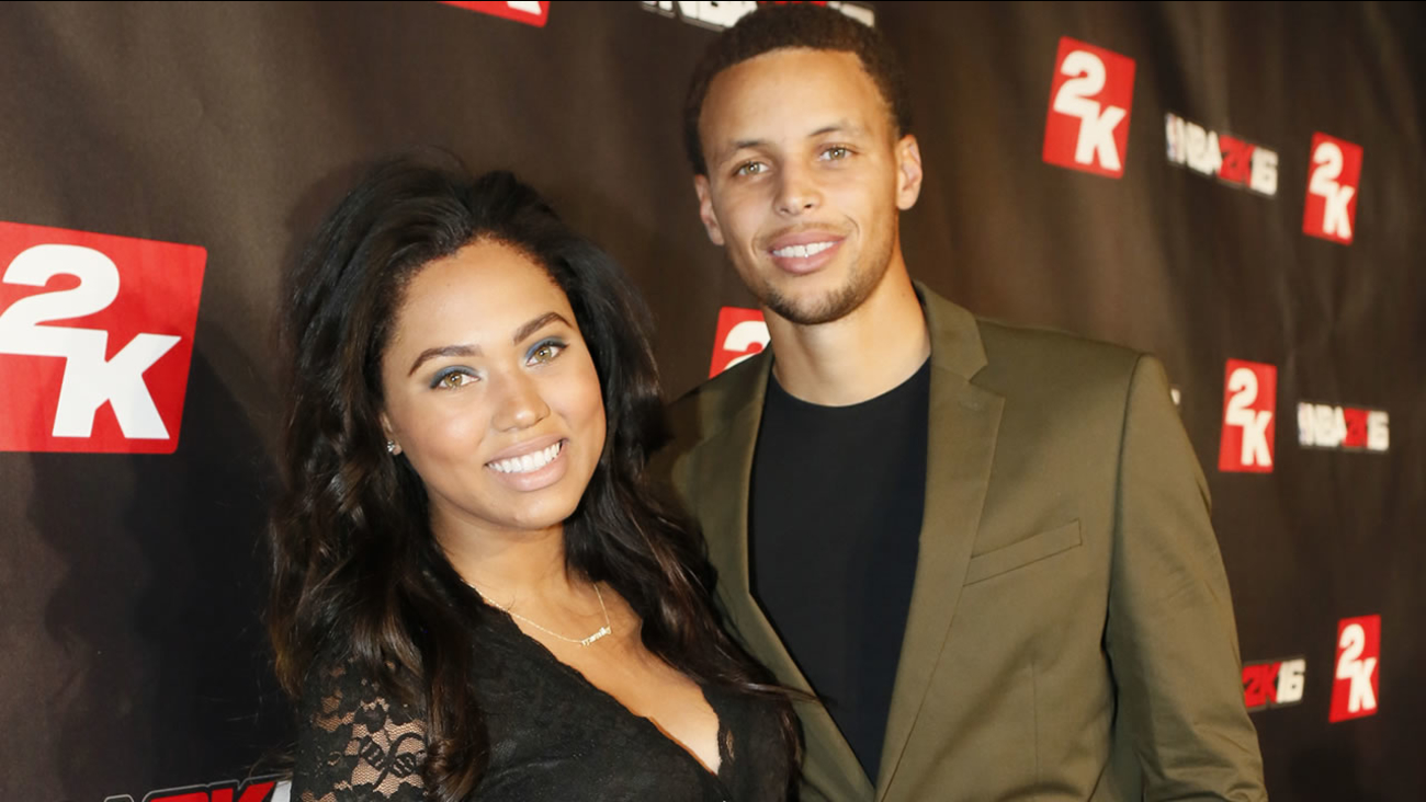 Steph Curry and his wife Ayesha pose on the red-carpet at the NBA 2K16 Uncensored Premiere Event at Marquee on Monday, Sept. 21, 2015, in New York. (Photo by Stuart Ramson/Invision for 2K/AP Images)