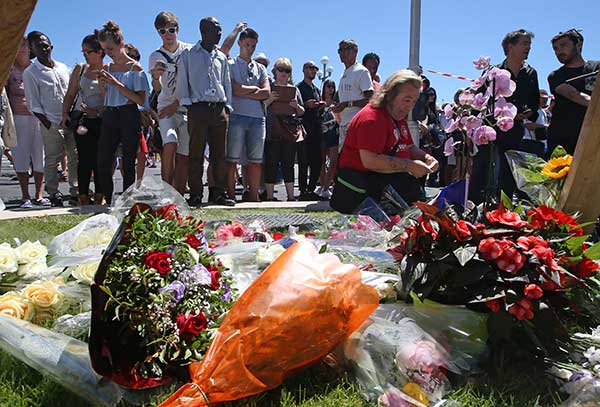 "<div class=""meta image-caption""><div class=""origin-logo origin-image none""><span>none</span></div><span class=""caption-text"">Floral tributes are laid out near the site of the truck attack in the French resort city of Nice, southern France, Friday, July 15, 2016. (Luca Bruno/AP Photo)</span></div>"