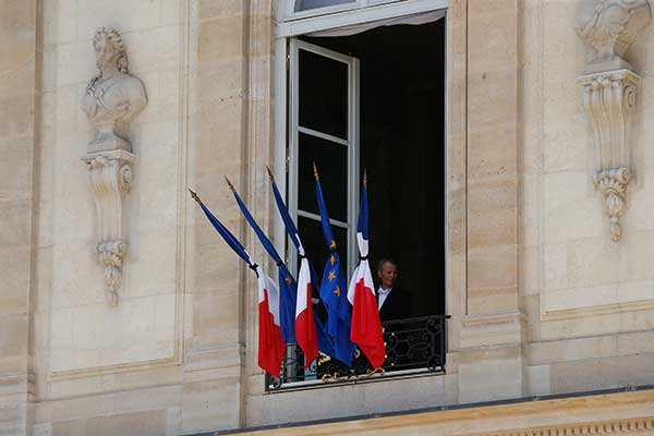 <div class='meta'><div class='origin-logo' data-origin='none'></div><span class='caption-text' data-credit='Thibault Camus/AP Photo'>A man stands next to a half staff French flags, at the Elysee palace in Paris, Friday, July 15, 2016.</span></div>