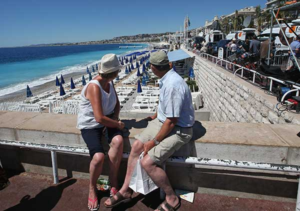 "<div class=""meta image-caption""><div class=""origin-logo origin-image none""><span>none</span></div><span class=""caption-text"">People sit overlooking the beach and not far from the site of the truck attack in the French resort city of Nice, southern France, Friday, July 15, 2016. (Luca Bruno/AP Photo)</span></div>"