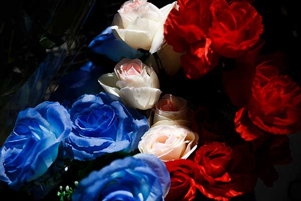 <div class='meta'><div class='origin-logo' data-origin='none'></div><span class='caption-text' data-credit='/AP Photo'>Flowers in the colors of the French flag are left on the fence of the French Embassy in Madrid, Spain, Friday, July 15, 2016.</span></div>