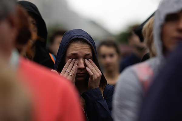 "<div class=""meta image-caption""><div class=""origin-logo origin-image none""><span>none</span></div><span class=""caption-text"">A woman weeps during an event to commemorate the victims of an attack in Nice near the French embassy in Berlin, Germany, Friday, July 15, 2016. (Markus Schreiber/AP Photo)</span></div>"