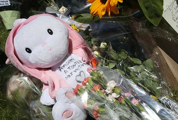 <div class='meta'><div class='origin-logo' data-origin='none'></div><span class='caption-text' data-credit='/AP Photo'>A child's toy is placed among the floral tributes laid out near the site of the truck attack in the French resort city of Nice, southern France, Friday, July 15, 2016.</span></div>