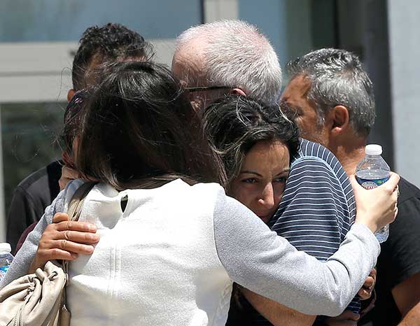 <div class='meta'><div class='origin-logo' data-origin='none'></div><span class='caption-text' data-credit='Claude Paris/AP Photo'>Relative of the victims of the Bastille Day attack comfort each other as they gather in front of Pasteur Hospital in Nice.</span></div>