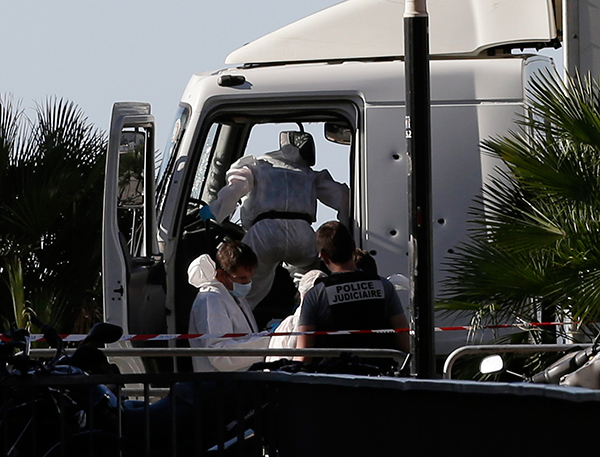 <div class='meta'><div class='origin-logo' data-origin='none'></div><span class='caption-text' data-credit='Claude Paris/AP Photo'>Forensic police officers work at the truck that plowed into the crowd in Nice, southern France, Friday July 15, 2016</span></div>