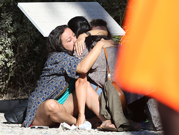 <div class='meta'><div class='origin-logo' data-origin='none'></div><span class='caption-text' data-credit='Luca Bruno/AP Photo'>Parents of victims embrace each other near the scene of a truck attack in Nice, southern France, Friday, July 15, 2016.</span></div>