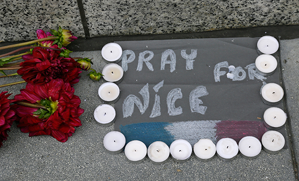 <div class='meta'><div class='origin-logo' data-origin='none'></div><span class='caption-text' data-credit='Eric Risberg/AP Photo'>Flowers and candles are left following the attacks in Nice outside the entrance to the French Consulate Friday, July 15, 2016.</span></div>