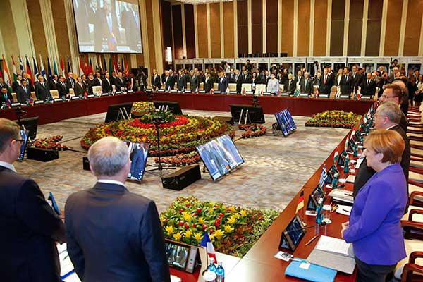 "<div class=""meta image-caption""><div class=""origin-logo origin-image none""><span>none</span></div><span class=""caption-text"">Leaders stand for a minute of silence before the opening session of the Asia-Europe Meeting (ASEM) summit in Ulaanbaa, Mongolia on Friday, July 15, 2016. (Damir Sagolj/Pool Photo via AP)</span></div>"