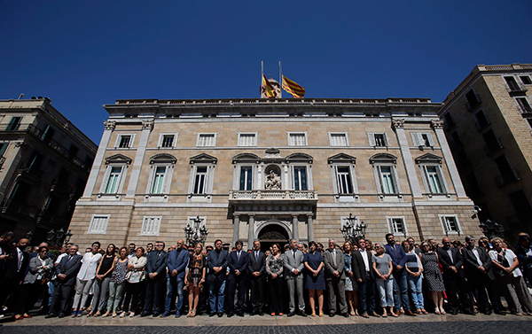 <div class='meta'><div class='origin-logo' data-origin='none'></div><span class='caption-text' data-credit='Manu Fernandez/AP Photo'>Catalan politics hold a minute of silence outside the Generalitat Palace, in Barcelona, Spain, Friday, July 15, 2016.</span></div>