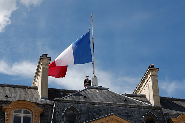 "<div class=""meta image-caption""><div class=""origin-logo origin-image none""><span>none</span></div><span class=""caption-text"">A soldier stands next to a half staff French flag, at the Elysee palace in Paris, Friday, July 15, 2016. (Thibault Camus/AP Photo)</span></div>"