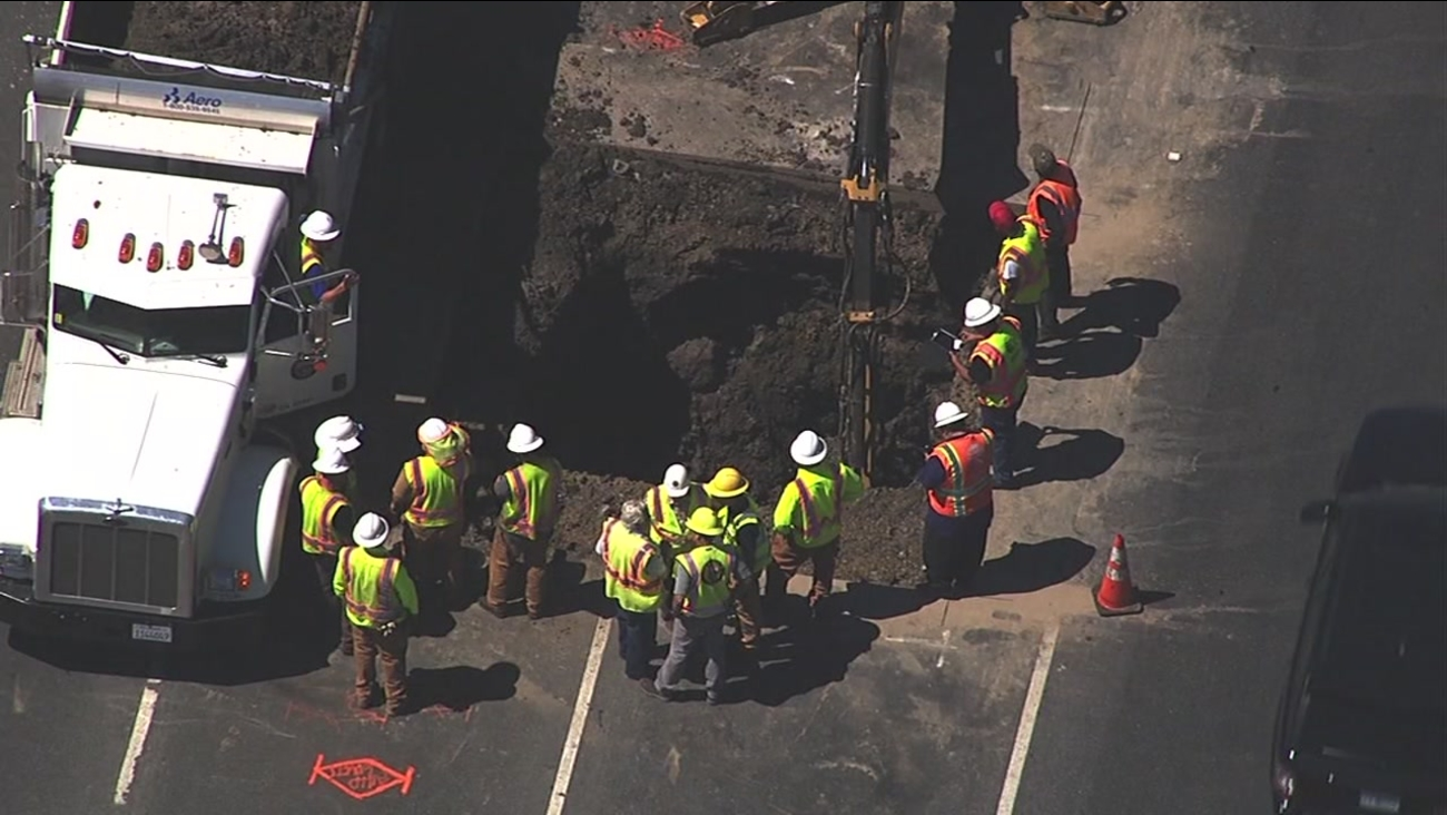 This image from Sky7 HD shows a sinkhole that closed a portion of Lawrence Expressway in Sunnyvale, Calif. on Friday, July 15, 2016.