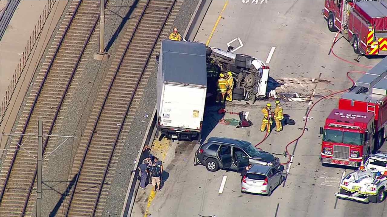 Pasadena fire officials respond to a deadly crash on the 210 Freeway on Friday, July 15, 2016.