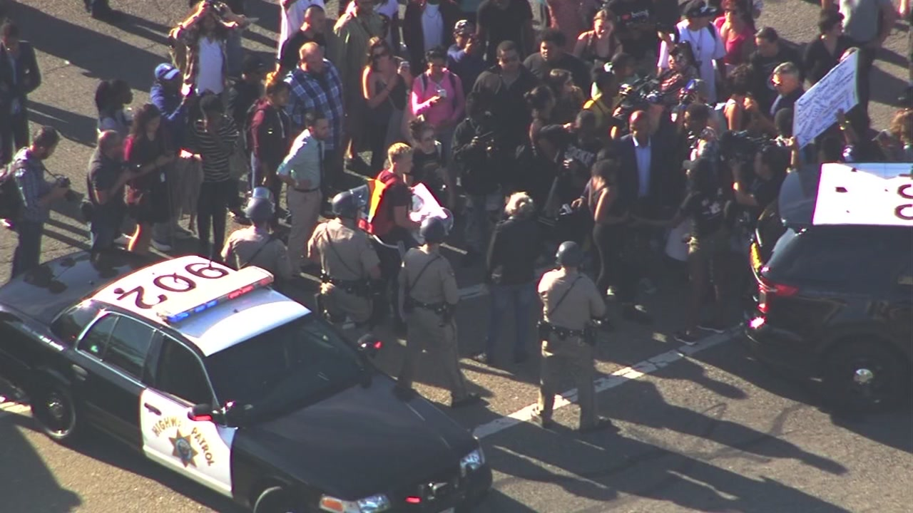 This image shows protesters clashing with Oakland police officers briefly at the on-ramp to Interstate 980 at Brush and 17th streets on July 15, 2016.