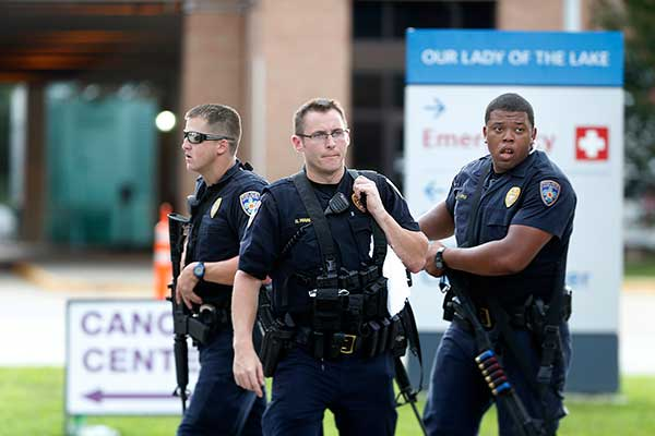 <div class='meta'><div class='origin-logo' data-origin='none'></div><span class='caption-text' data-credit='Gerald Herbert/AP Photo'>Police guard the emergency room entrance of Our Lady Of The Lake Medical Center, where wounded officers were brought, in Baton Rouge, La., Sunday, July 17, 2016.</span></div>