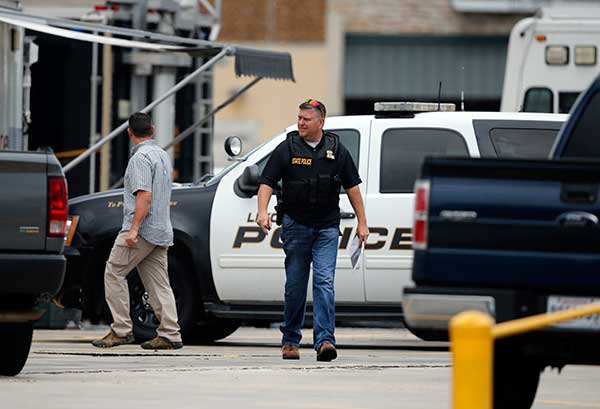 <div class='meta'><div class='origin-logo' data-origin='none'></div><span class='caption-text' data-credit='Gerald Herbert/AP Photo'>Law enforcement work the crime scene where Baton Rouge police were shot, in Baton Rouge, La., Sunday, July 17, 2016.</span></div>