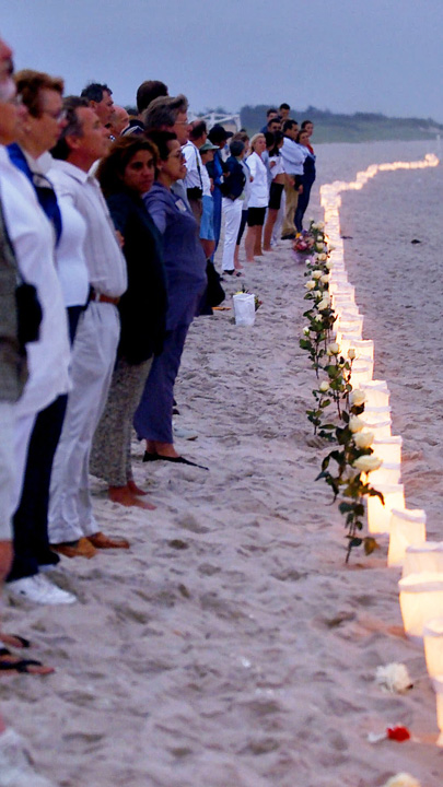 <div class='meta'><div class='origin-logo' data-origin='none'></div><span class='caption-text' data-credit='AP Photo/Ed Betz, File'>FILE - In this July 17, 2000, file photo, family members and friends of victims of TWA Flight 800 hold hands after lighting 230 candles.</span></div>