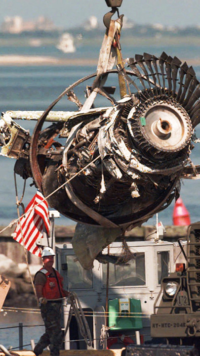<div class='meta'><div class='origin-logo' data-origin='none'></div><span class='caption-text' data-credit='AP Photo/Mark Lennihan, File'>FILE - In this Aug. 15, 1996, file photo, the final engine to be salvaged from the wreckage of TWA Flight 800 is loaded by crane onto a truck.</span></div>