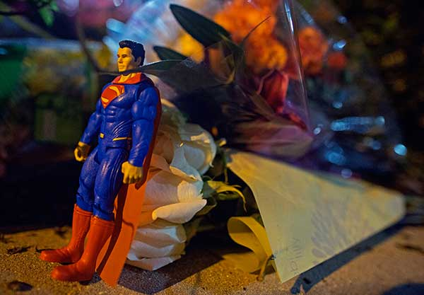 <div class='meta'><div class='origin-logo' data-origin='none'></div><span class='caption-text' data-credit='Max Becherer/AP Photo'>A Superman figure and flowers are left at the entrance to the Our Lady of the Lake Regional Medical Center in Baton Rouge, La., Sunday, July 17, 2016.</span></div>