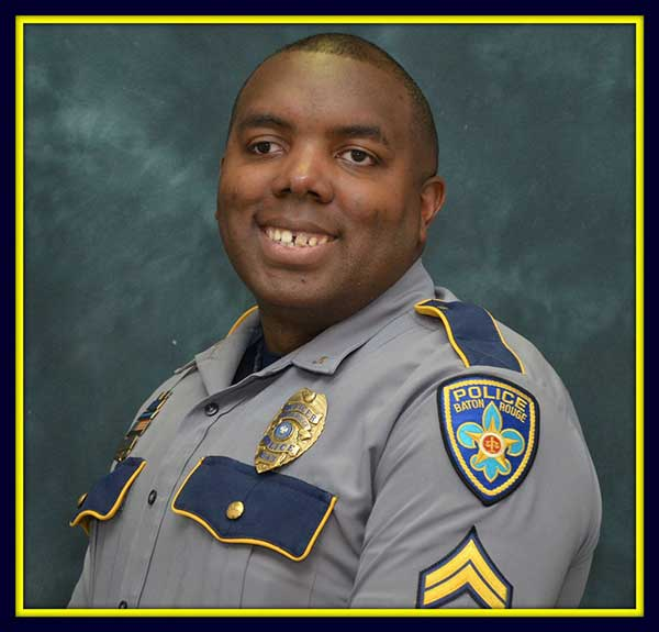 <div class='meta'><div class='origin-logo' data-origin='none'></div><span class='caption-text' data-credit='Baton Rouge Police Dept. via AP'>This undated photo made available by the Baton Rouge Police Dept. shows officer Montrell Jackson. Jackson, 32, has been identified as one of the police officers killed.</span></div>
