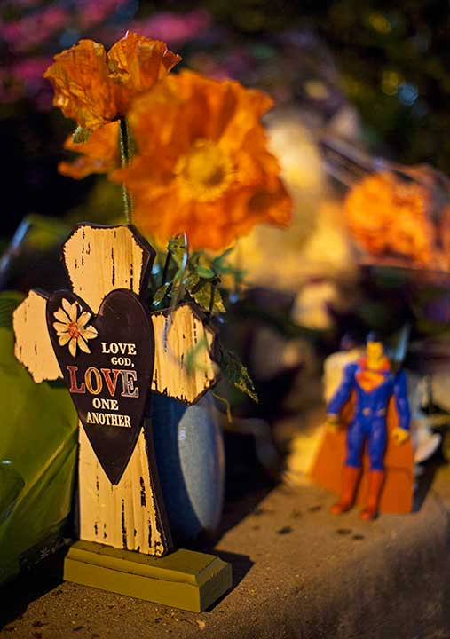 <div class='meta'><div class='origin-logo' data-origin='none'></div><span class='caption-text' data-credit='Max Becherer/AP Photo'>Flowers and crosses are left at the entrance to the Our Lady of the Lake Regional Medical Center in Baton Rouge, La., Sunday, July 17, 2016.</span></div>