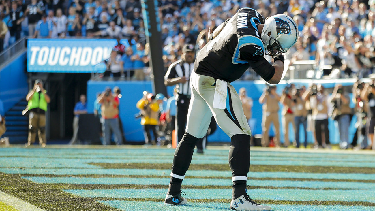 Carolina Panthers quarterback Cam Newton (1) celebrates a touchdown against the Atlanta Falcons during an NFL football game at Bank of America Stadium in Charlotte, N.C.