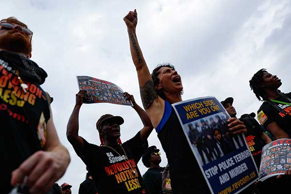 "<div class=""meta image-caption""><div class=""origin-logo origin-image none""><span>none</span></div><span class=""caption-text"">Demonstrators react during an End Poverty Now rally on Monday, July 18, 2016, in Cleveland. (John Minchillo/AP Photo)</span></div>"