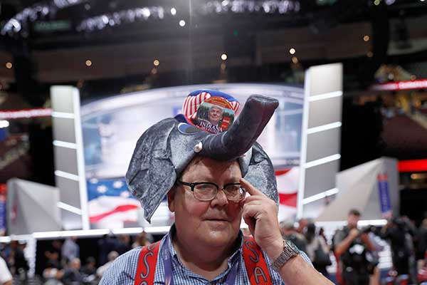"<div class=""meta image-caption""><div class=""origin-logo origin-image none""><span>none</span></div><span class=""caption-text"">Indiana delegate William Springer wears an elephant hat with Trump button as he walks around the convention floor before the evening session on Monday. (Carolyn Kaster/AP Photo)</span></div>"