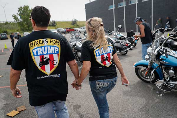 "<div class=""meta image-caption""><div class=""origin-logo origin-image none""><span>none</span></div><span class=""caption-text"">Supporters participate in a Bikers for Trump rally and ride for Republican Presidential candidate Donald Trump on Monday, July 18, 2016, in Cleveland. (John Minchillo/AP Photo)</span></div>"