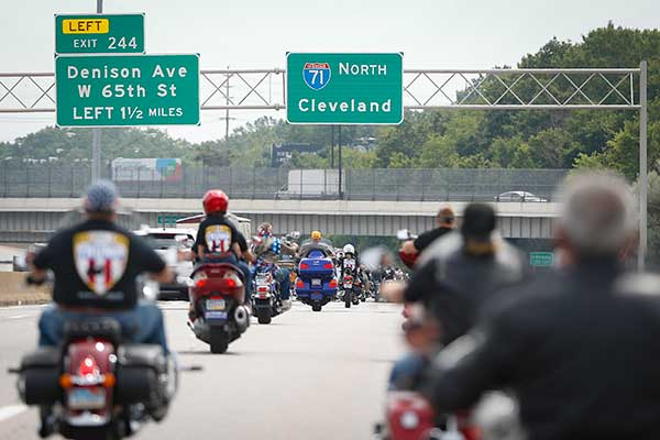 <div class='meta'><div class='origin-logo' data-origin='none'></div><span class='caption-text' data-credit='John Minchillo/AP Photo'>Members of the group Bikers for Trump ride to a rally for Republican presidential candidate Donald Trump at Settlers Landing Park on Monday, July 18, 2016, in Cleveland.</span></div>