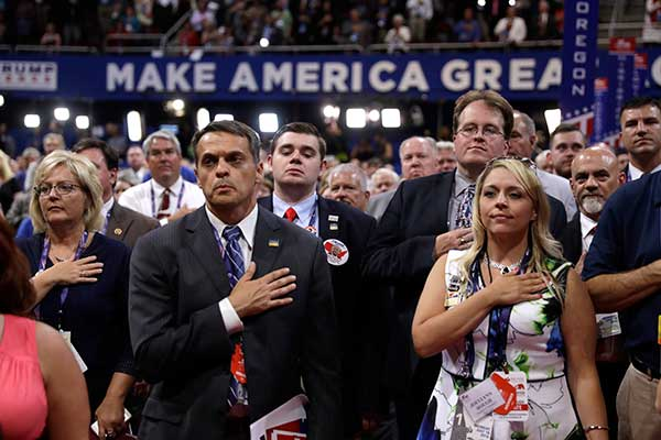 <div class='meta'><div class='origin-logo' data-origin='none'></div><span class='caption-text' data-credit='Matt Rourke/AP Photo'>Delegates put their hands on their chests as they sing the national anthem during first day of the Republican National Convention in Cleveland, Monday, July 18, 2016.</span></div>