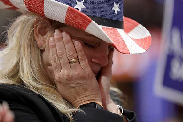 "<div class=""meta image-caption""><div class=""origin-logo origin-image none""><span>none</span></div><span class=""caption-text"">California delegate Donna Lowe cries as she listens to a speech by retired U.S. Navy Seal Marcus Luttrell during first day of the Republican National Convention on Monday. (John Locher/AP Photo)</span></div>"