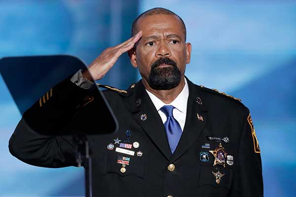 "<div class=""meta image-caption""><div class=""origin-logo origin-image none""><span>none</span></div><span class=""caption-text"">David Clarke, Sheriff of Milwaukee County, Wis., salutes after speaking during the opening day of the Republican National Convention in Cleveland (J. Scott Applewhite/AP Photo)</span></div>"