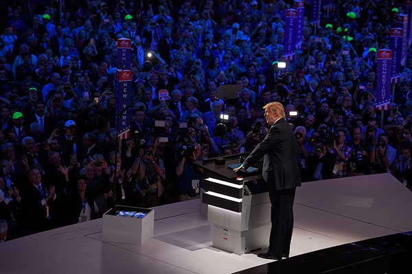 "<div class=""meta image-caption""><div class=""origin-logo origin-image none""><span>none</span></div><span class=""caption-text"">Republican Presidential Candidate Donald Trump steps to the podium to introduce his wife Melania during the opening day of the Republican National Convention in Cleveland. (Mark J. Terrill/AP Photo)</span></div>"