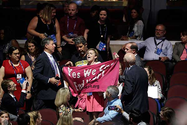 "<div class=""meta image-caption""><div class=""origin-logo origin-image none""><span>none</span></div><span class=""caption-text"">A protester scuffles with others delegates during first day of the Republican National Convention in Cleveland. (John Locher/AP Photo)</span></div>"