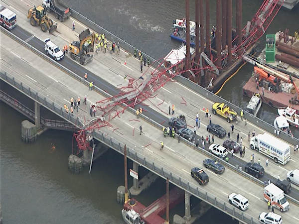 <div class='meta'><div class='origin-logo' data-origin='WABC'></div><span class='caption-text' data-credit='NewsCopter 7'>Photos from NewsCopter 7 of the crane collapse on the Tappan Zee Bridge on Tuesday, July 19, 2016.</span></div>