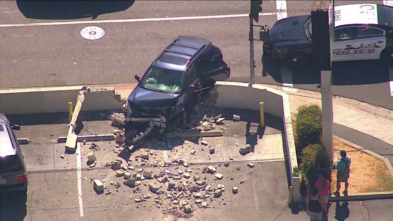 A car is seen smashed into a wall at the corner of Maine Avenue and Olive Street in Baldwin Park following a police chase on Tuesday, July 19, 2016.