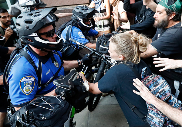 <div class='meta'><div class='origin-logo' data-origin='AP'></div><span class='caption-text' data-credit='John Minchillo/AP'>Protesters clash with police on Tuesday, July 19, 2016, in Cleveland, during the second day of the Republican convention.</span></div>
