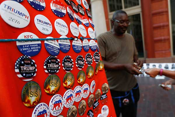 "<div class=""meta image-caption""><div class=""origin-logo origin-image none""><span>none</span></div><span class=""caption-text"">A vendor sells buttons on Euclid Avenue on the second day of the Republican National Convention on Tuesday, July 19, 2016, in Cleveland. (John Minchillo/AP Photo)</span></div>"