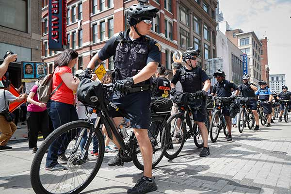 "<div class=""meta image-caption""><div class=""origin-logo origin-image none""><span>none</span></div><span class=""caption-text"">Bicycle police officers guard the street during a protest against the Republican National Convention on Tuesday, July 19, in Cleveland, during the second day of the convention. (John Minchillo/AP Photo)</span></div>"