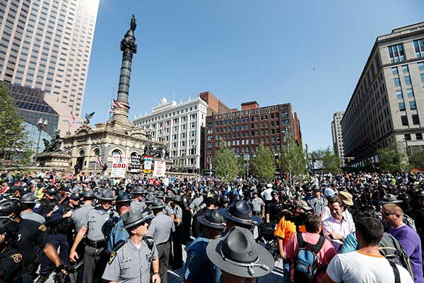 <div class='meta'><div class='origin-logo' data-origin='none'></div><span class='caption-text' data-credit='John Minchillo/AP Photo'>Police officers stand guard in Public Square as various protests are underway outside the Republican National Convention on the second day, July 19.</span></div>