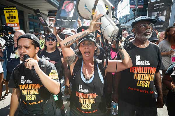 <div class='meta'><div class='origin-logo' data-origin='none'></div><span class='caption-text' data-credit='John Minchillo/AP Photo'>Protesters march in downtown on Tuesday, July 19, 2016, in Cleveland, during the second day of the convention.</span></div>