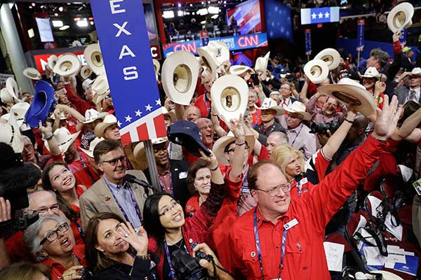 "<div class=""meta image-caption""><div class=""origin-logo origin-image none""><span>none</span></div><span class=""caption-text"">Texas delegates cheer during the second day session of the Republican National Convention in Cleveland, Tuesday, July 19, 2016. (John Locher/AP Photo)</span></div>"
