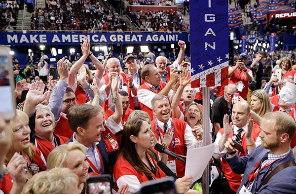 "<div class=""meta image-caption""><div class=""origin-logo origin-image none""><span>none</span></div><span class=""caption-text"">Michigan delegates cheer during the second day session of the Republican National Convention in Cleveland, Tuesday, July 19. (Matt Rourke/AP Photo)</span></div>"