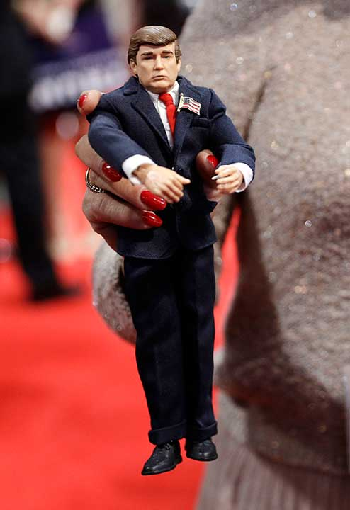 "<div class=""meta image-caption""><div class=""origin-logo origin-image none""><span>none</span></div><span class=""caption-text"">A Pennsylvania delegate holds up a figure of Republican Presidential Candidate Donald Trump during the second day session of the Republican National Convention. (John Locher/AP Photo)</span></div>"